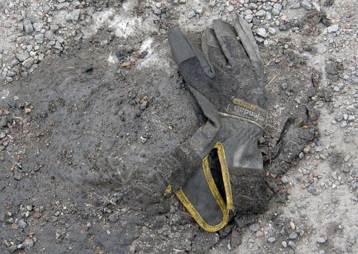 Worker's glove with yellow band, Hisingsgatan, Gothenburg, Sweden 9 Mar '11 08.33