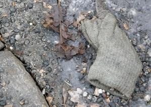 Glove in gutter at Virvelvindsgatan, Gothenburg, Sweden 9 Mar '11