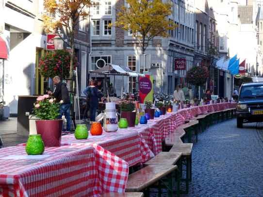 Maastricht: Preparing for a street party on Rechtstraat in Wyck