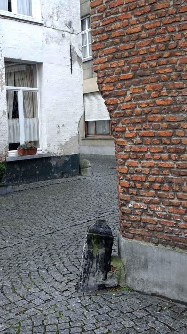 Bollards on opposite cornersin the Large Beguinage, Mechelen