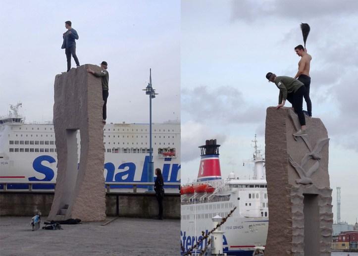 Drunks climb sculpture