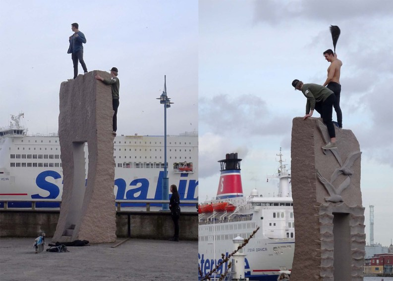 Drunks climb sculpture
