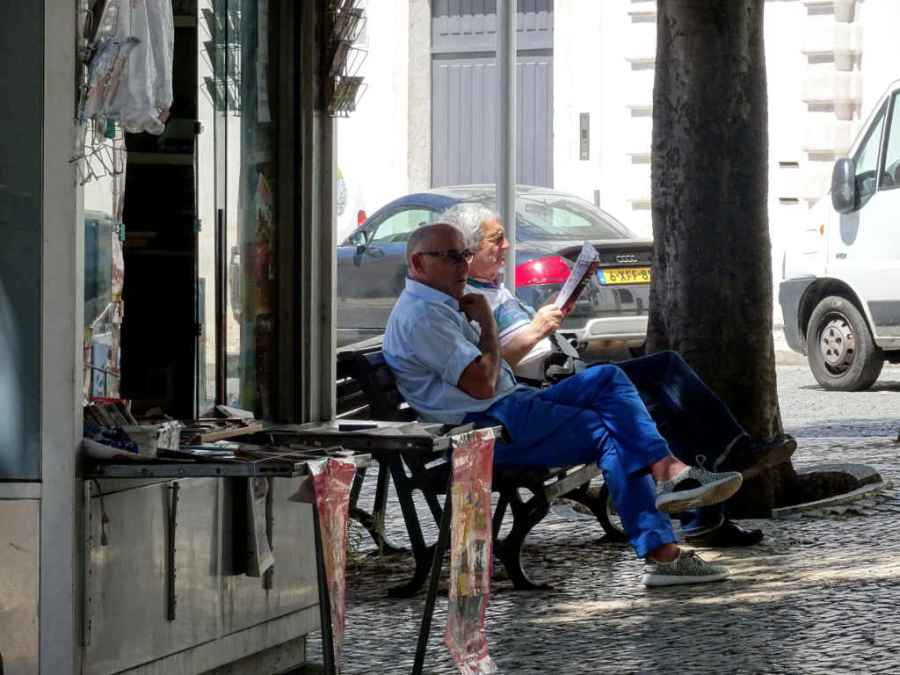 Wednesday - Bairro Alto, Lisbon - street scene - reading the news
