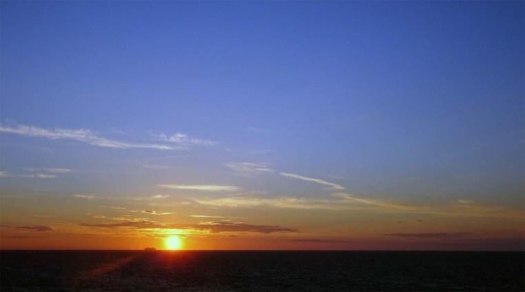 Ship on the horizon and a setting sun Kattegat