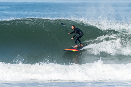 Stand up paddle surfer riding a wave