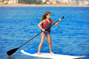 child paddling on sup
