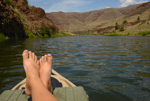 relaxing on a kayak in a beautiful landscape