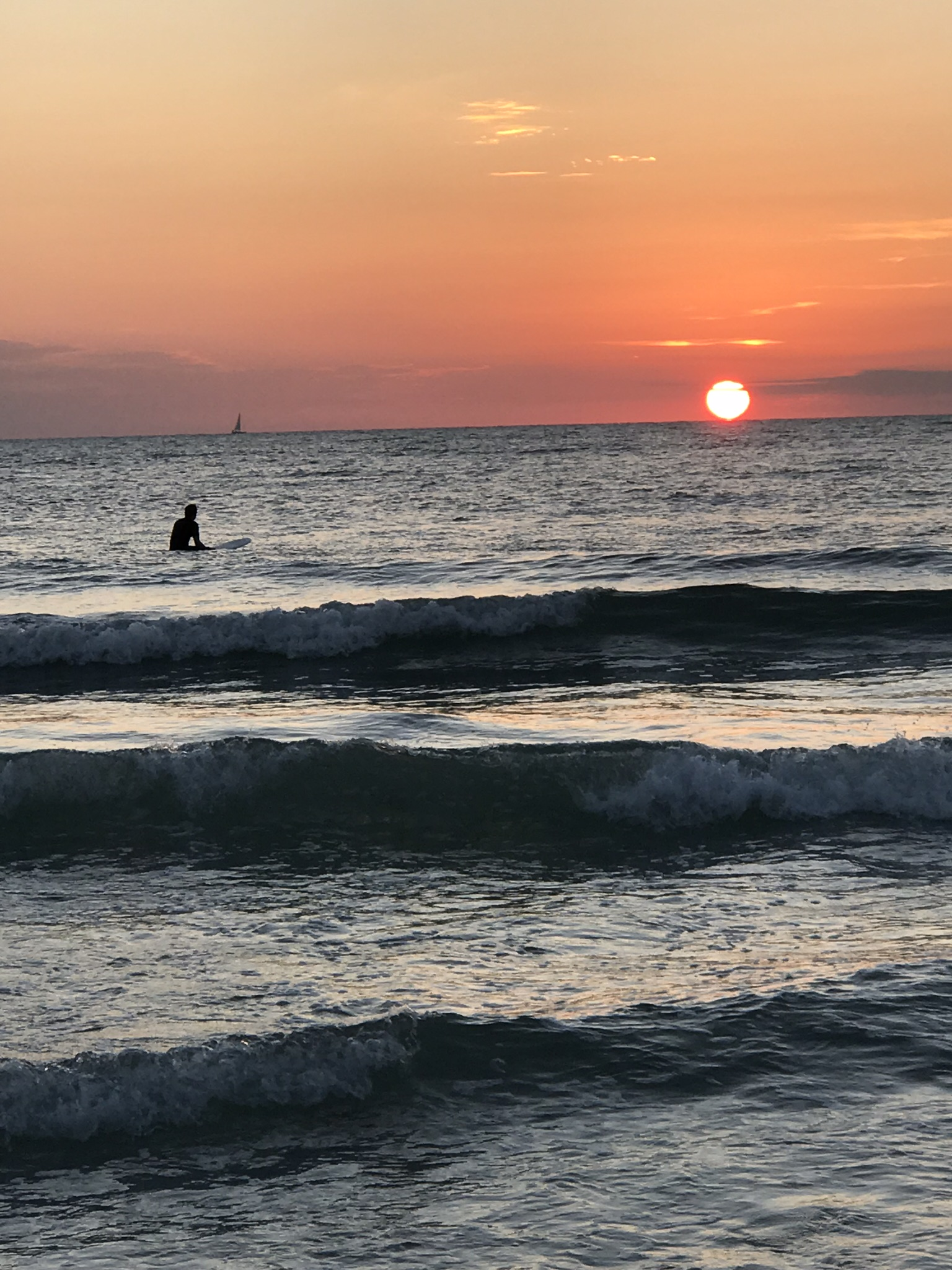 sunset surfer at Lido Key Beach