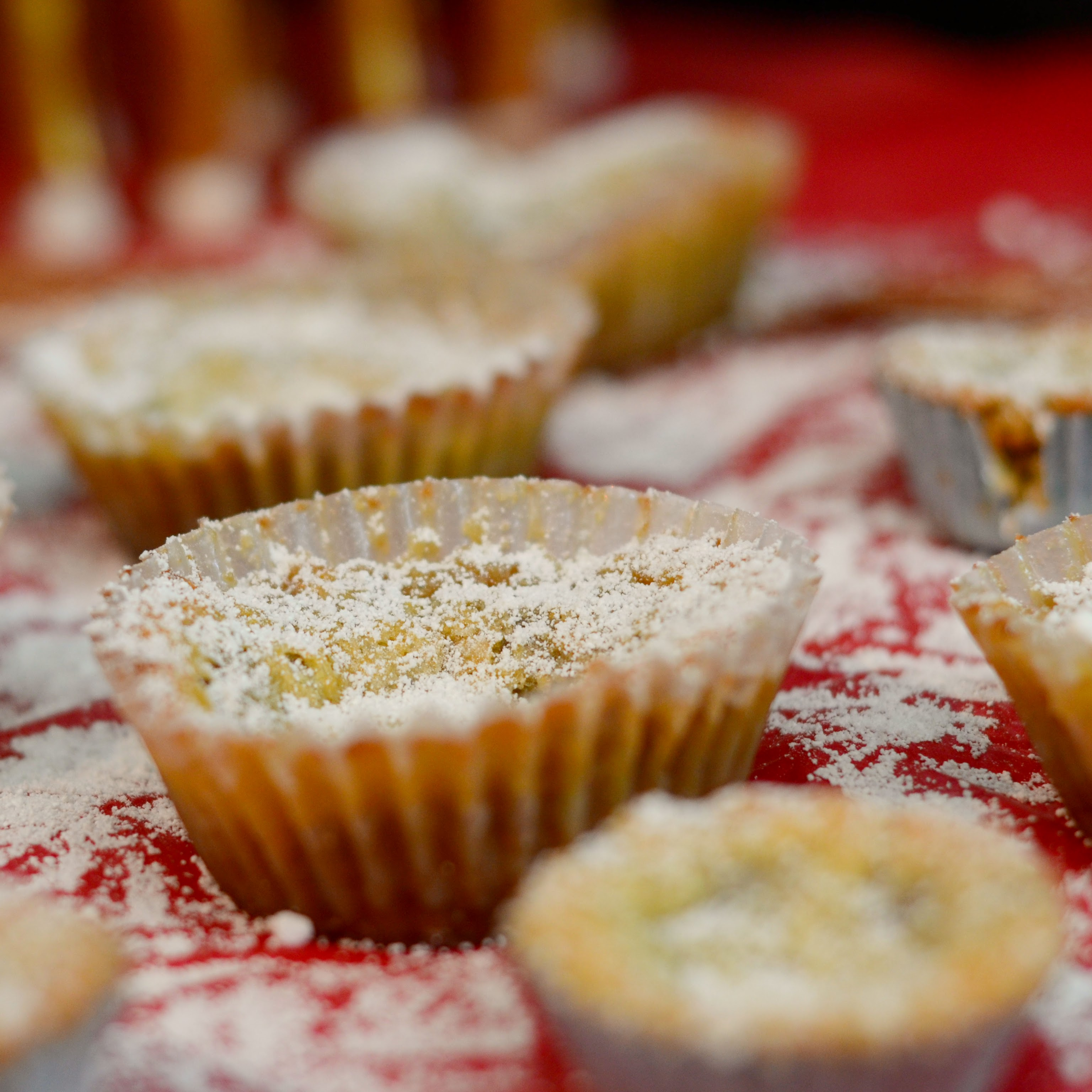 Crack Pie Cookies sprinkled with powdered sugar on red background