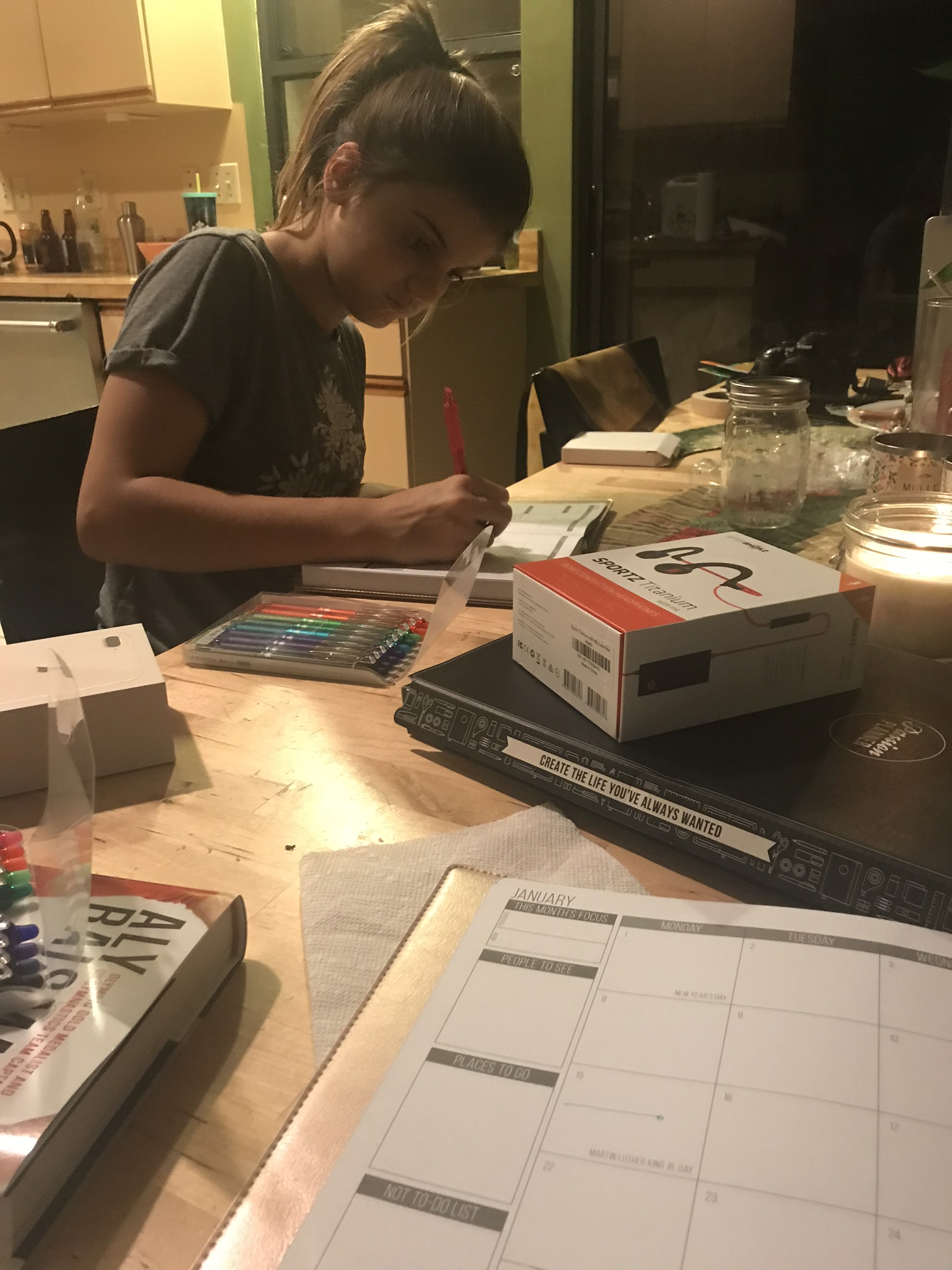 Girl writing in her passion planner