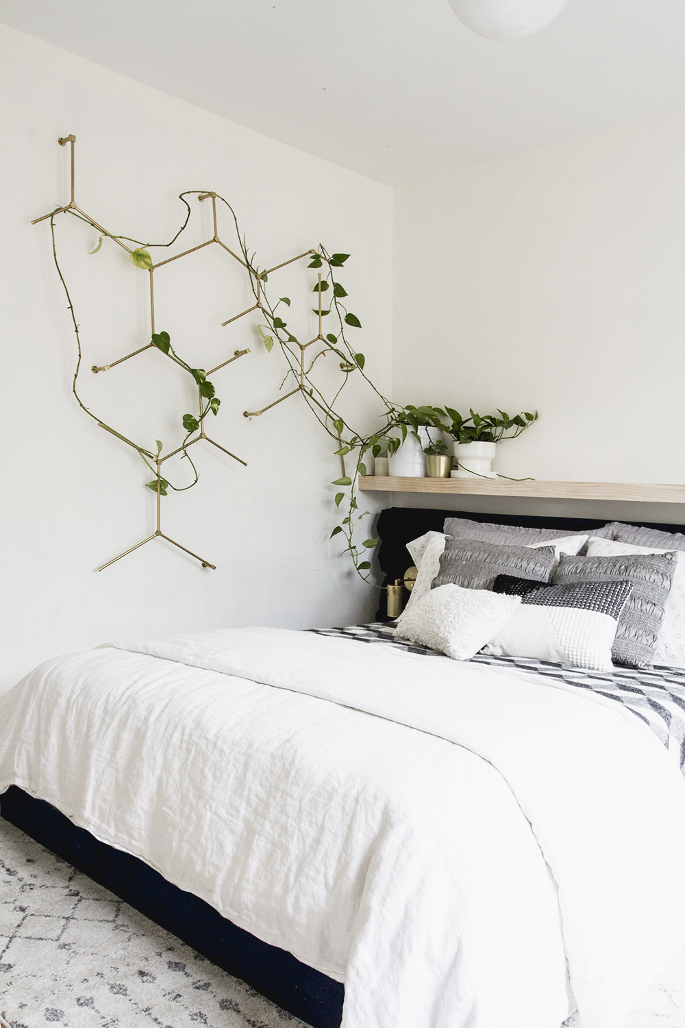 Brass Hex Trellis with Velvet Channel Tufted Headboard Guest Room | Deuce Cities Hen House