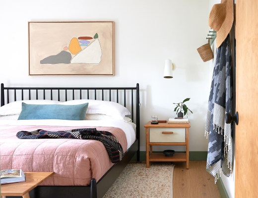 Modern Oak Floors, Spindle bed, and sconce over nightstand