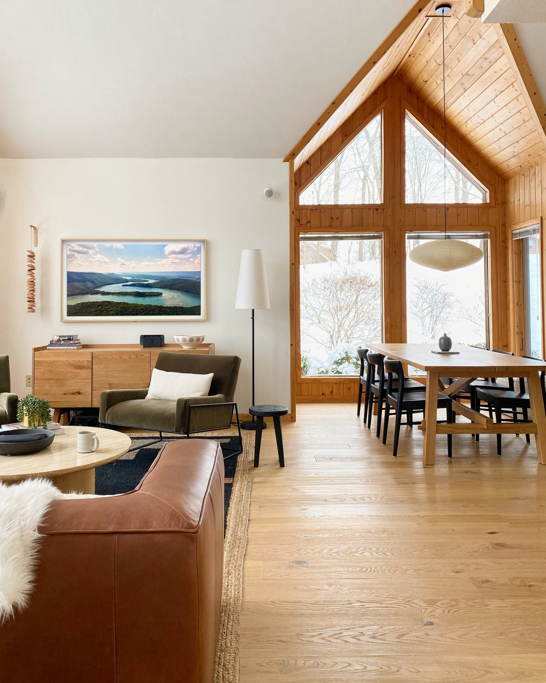 Cabin Interior with wood floors and a view of the snow