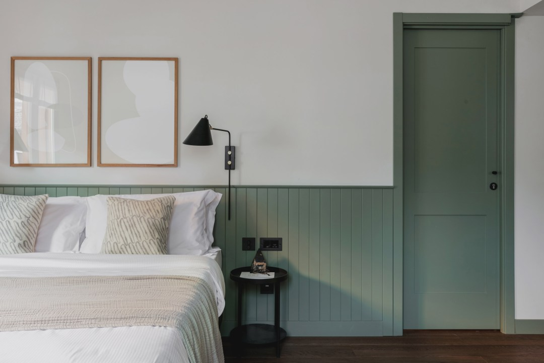 Green paneling and trim in bedroom