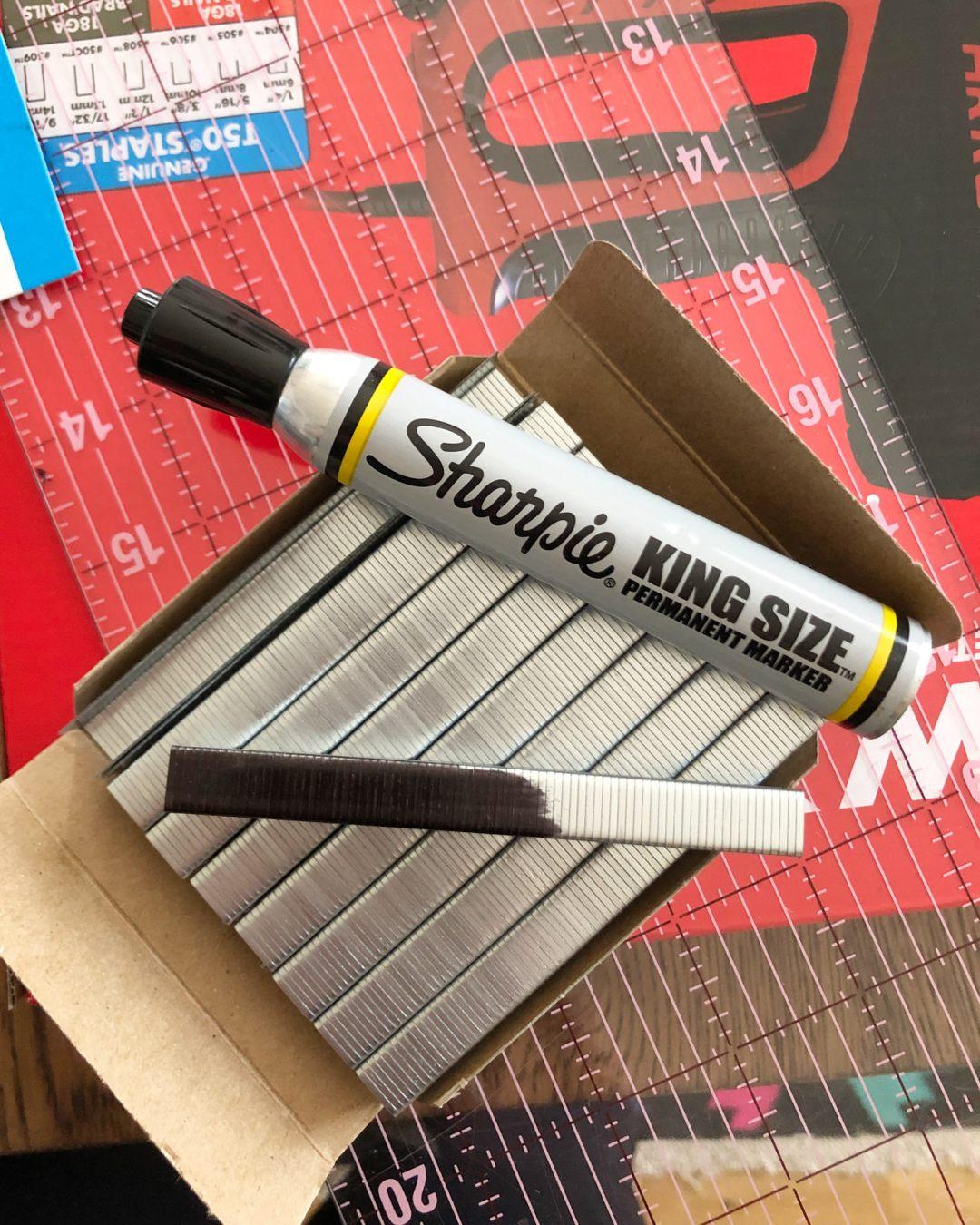 Blacken staples with sharpie