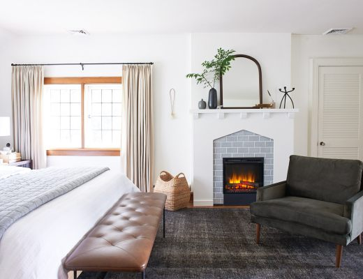 Master bedroom with fireplace and article furniture