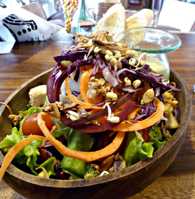 Focus on fruits and veggies, like this salad in Ubud, Bali, when traveling.