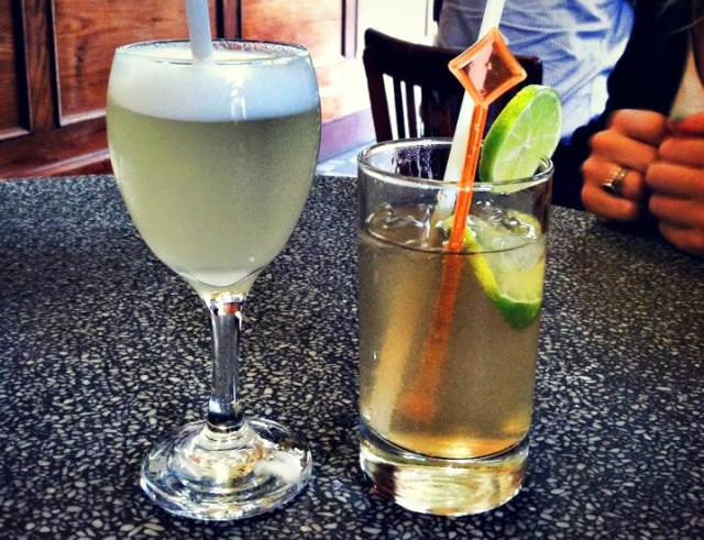 South American drinks you must try during your travels: Pisco Sour on the left, Chilcano on the right.