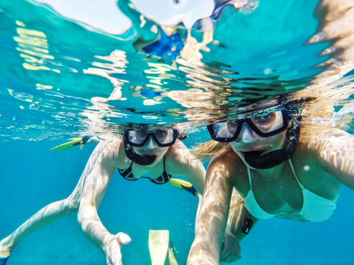 Girls snorkelling in the Caribbean