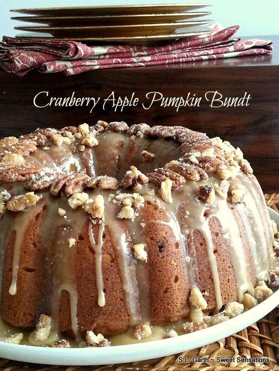 If you're looking for a cake that's filled with the warming spices of fall, nuts and fruits; try this Cranberry Apple Pumpkin Bundt.
