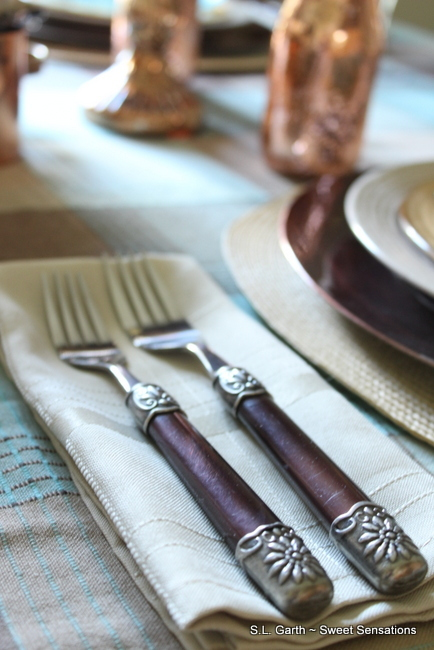 Fresh gourds and a textured tablecloth create warmth in this early autumn Plaid and Copper tablescape.