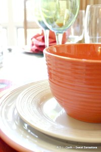 This fun and casual summer tablescape includes pops of orange that brightened a dreary day.