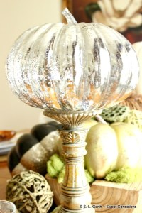 My Pared Down Thanksgiving Tablescape with Dough Bowl Centerpiece holds faux pumpkins and bowl filler to create a fall ambiance.
