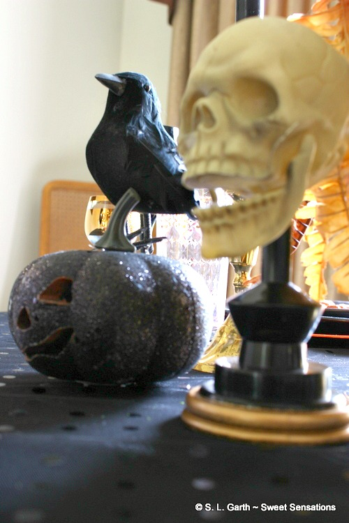 Maggie's Dark and Moody Halloween Tablescape is a tad macabre with a touch of elegance.
