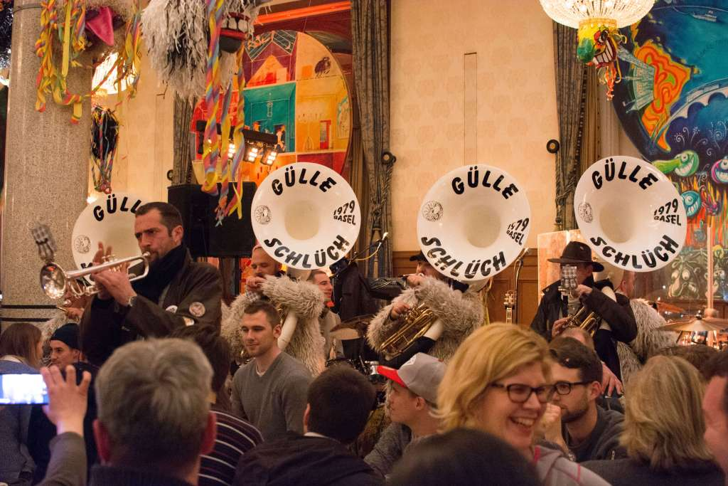 Guggemusig band making its entrance into a restaurant  at the Basler Fasnacht