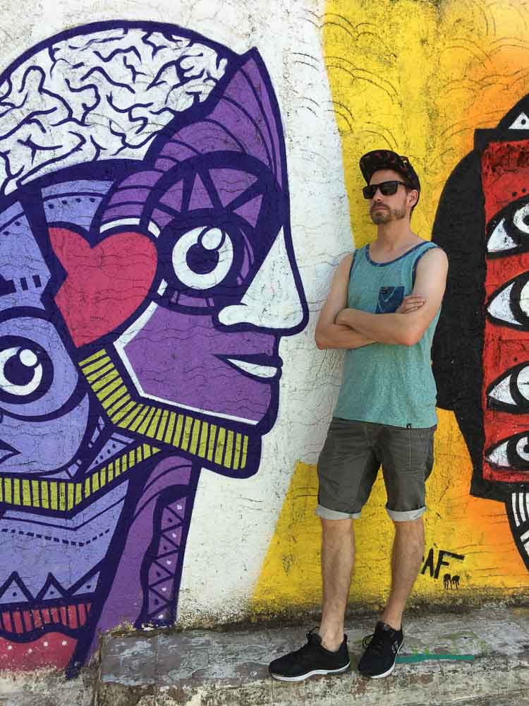 Jerry Posing with Graffiti Artwork in Plaka