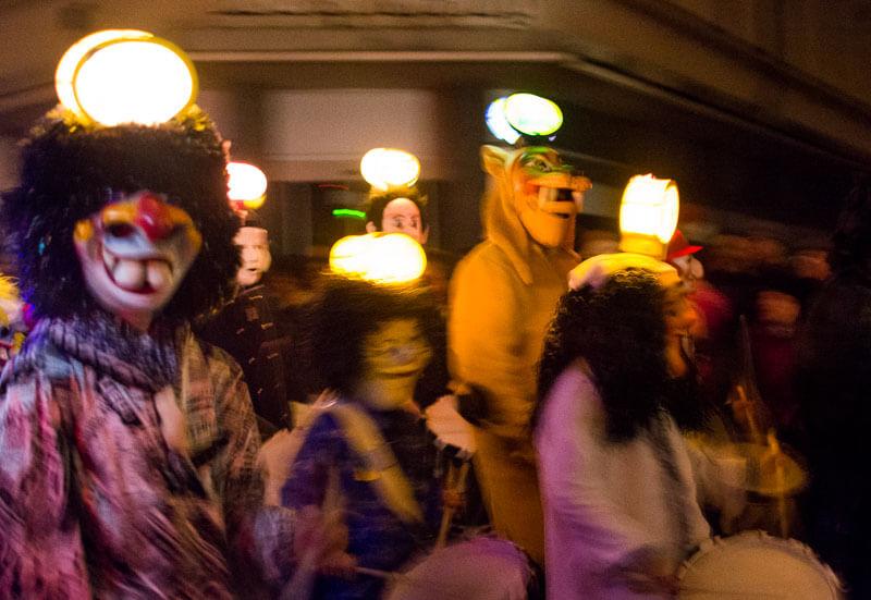 Clique Members Wearing Head Lanterns