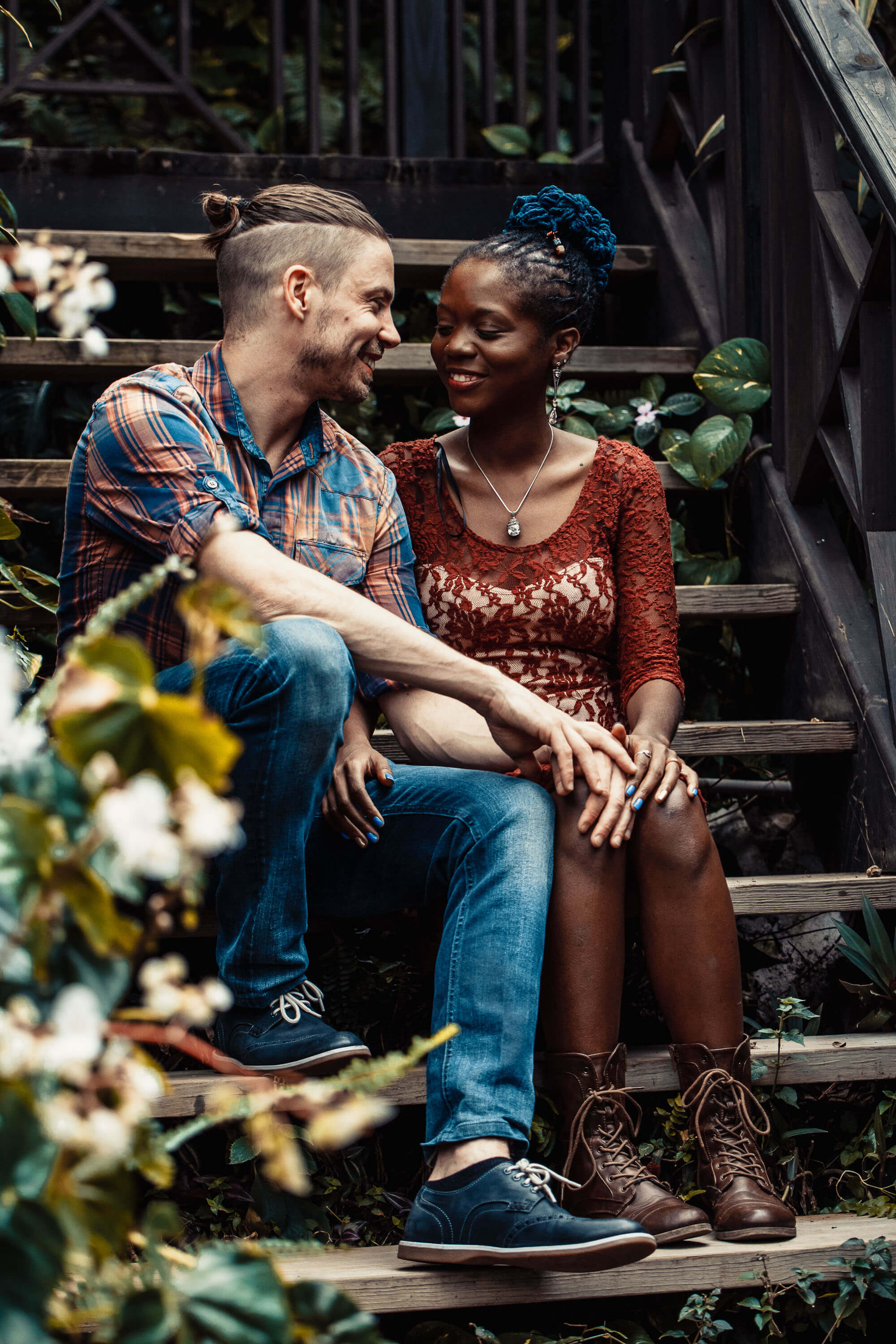 Couple sitting on wooden steps in nature