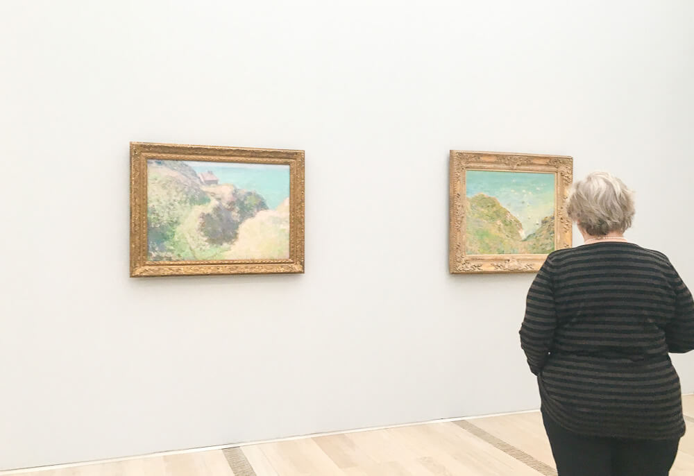 Exhibition Guest Viewing Monet's Mediterranean Paintings