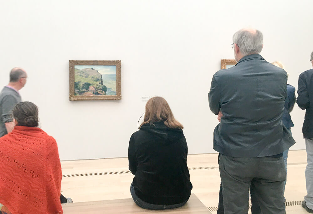 Exhibition Guests Viewing Monet's Mediterranean Paintings