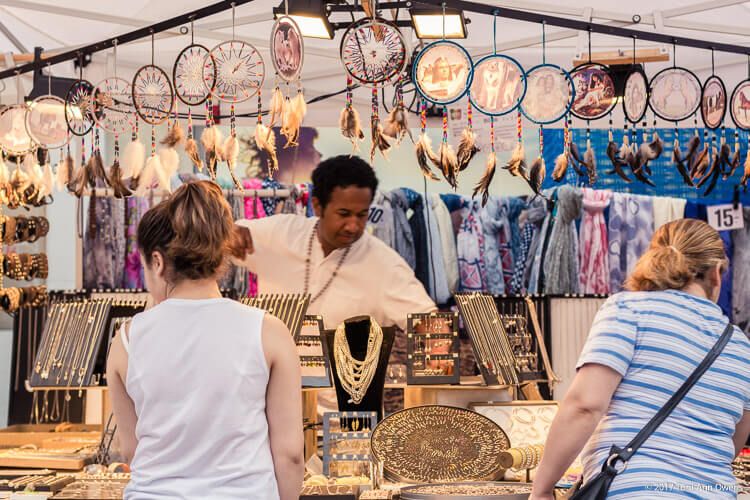 Vendor selling dream catchers and jewelry at the day market