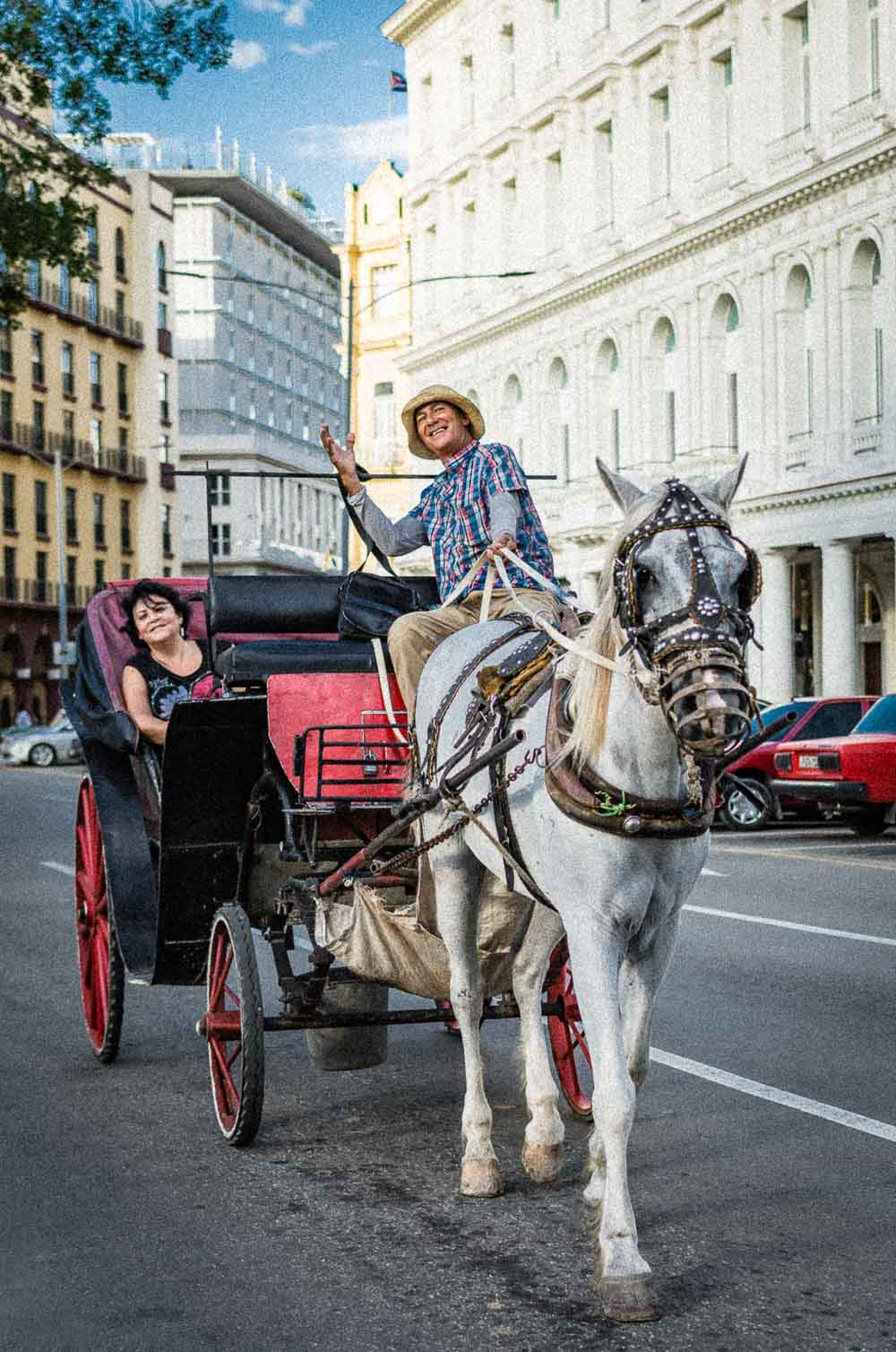 A happy horse carriage driver in Havana