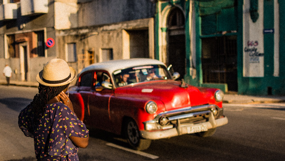 Toni admiring an antique car in Havana Cuba