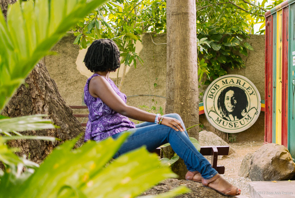 Girl looking at a sign at the Bob Marley Museum in Kingston Jamaica