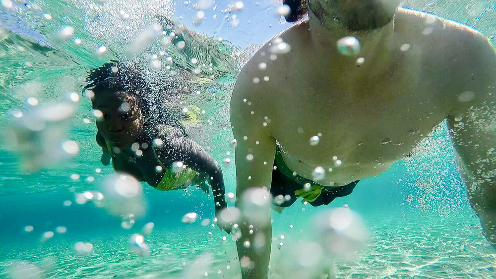 Swimming at Molos Beach in Paros Greece