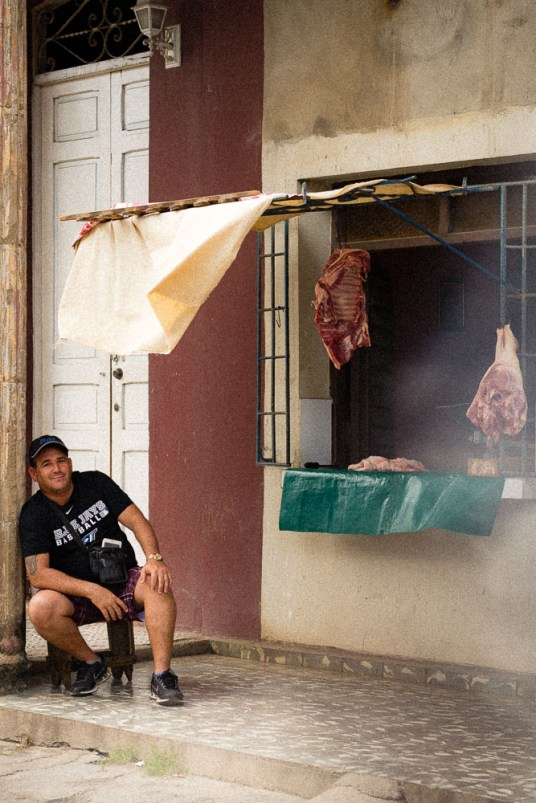 Butcherman in front of a shop