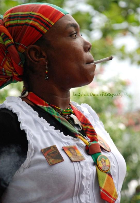 Rasta woman smoking a spliff