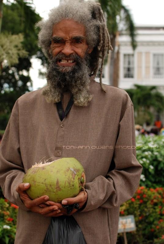 Rasta man with a coconut