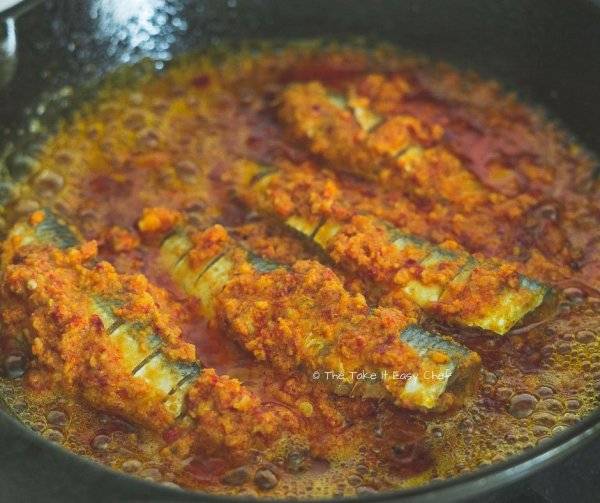 Thalassery Style Sardine Fry Steps - Sardines are placed on the frying pan