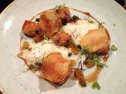 Confit Chicken Wings, Potato Tryffle Cream, Golden raisin