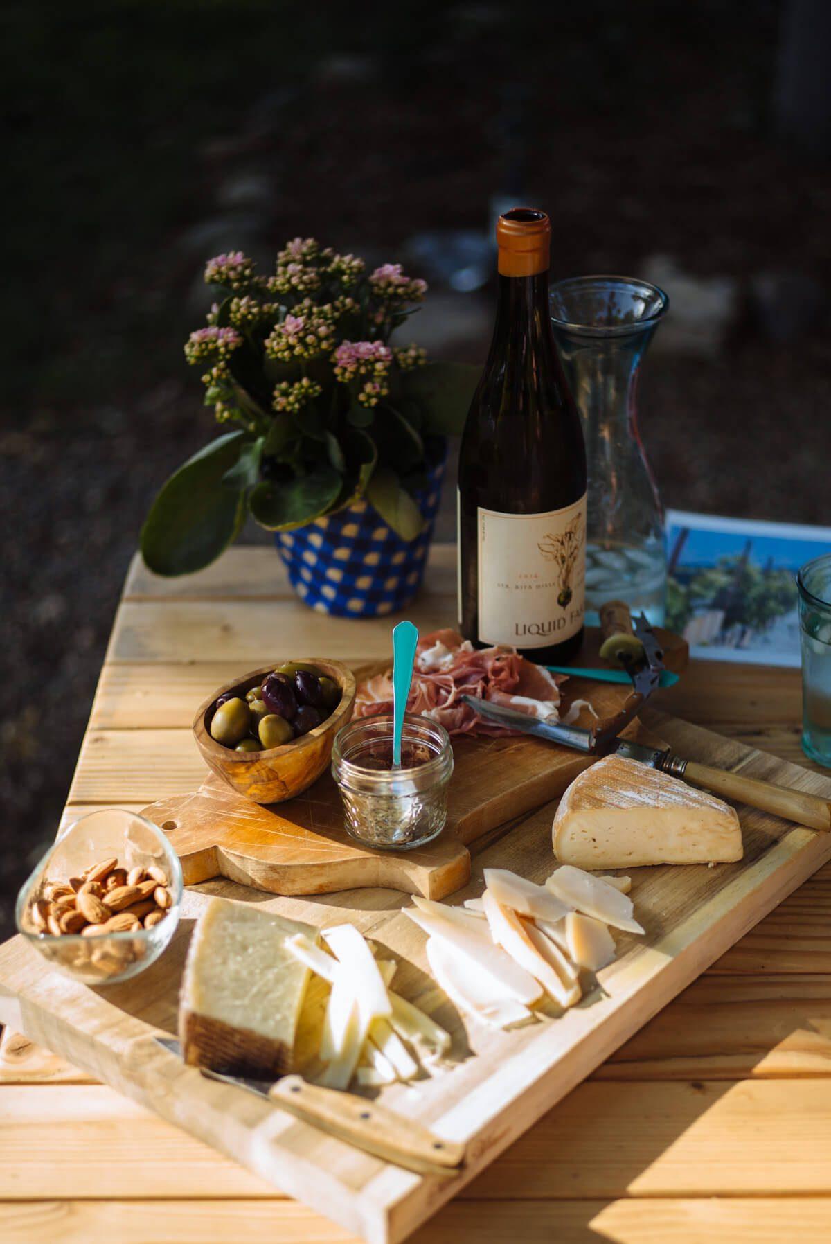 Liquid Farm's Golden Slope wine with charcuterie board - The Taste SF tasting outside in Santa Ynez Valley