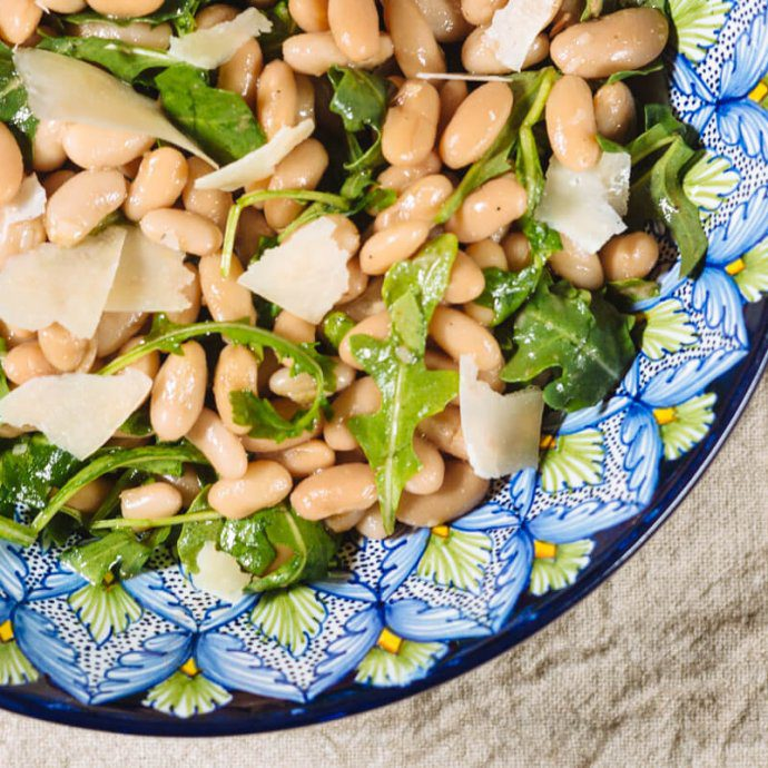 The Taste SF serves their recipe for white bean salad, arugula, and grana padano