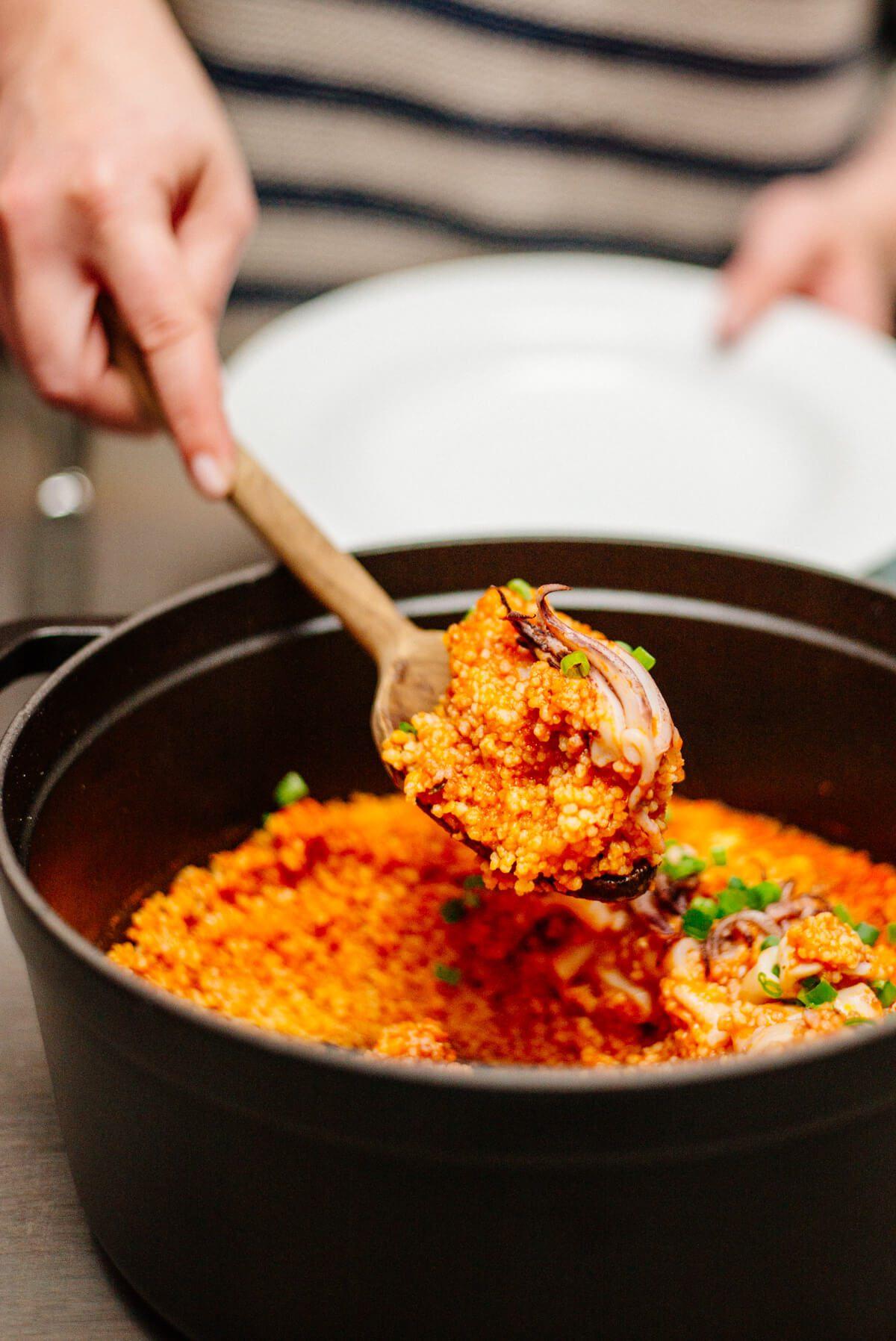 Serving up Calamari in spicy tomato sauce