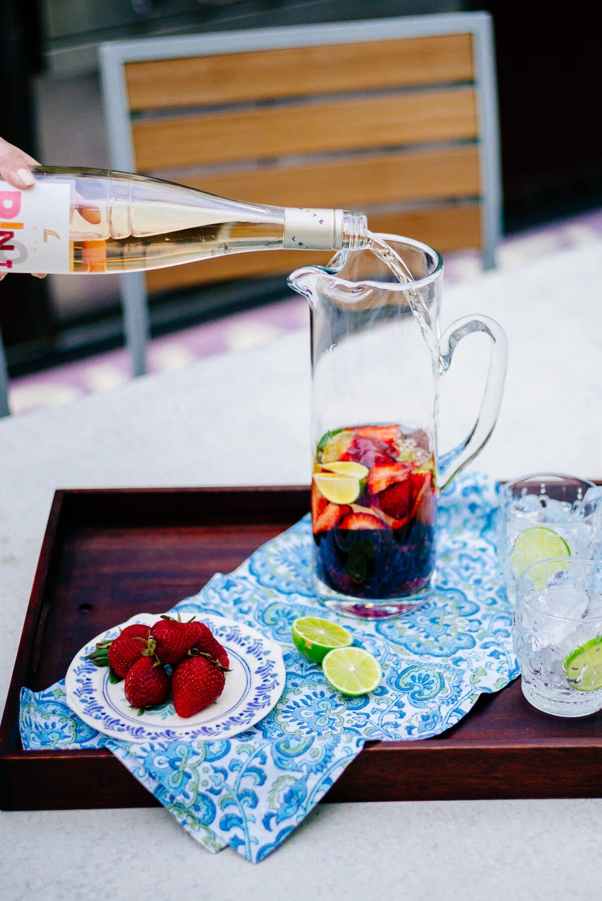 Making Rose Sangria for the summer with berries and stone fruit