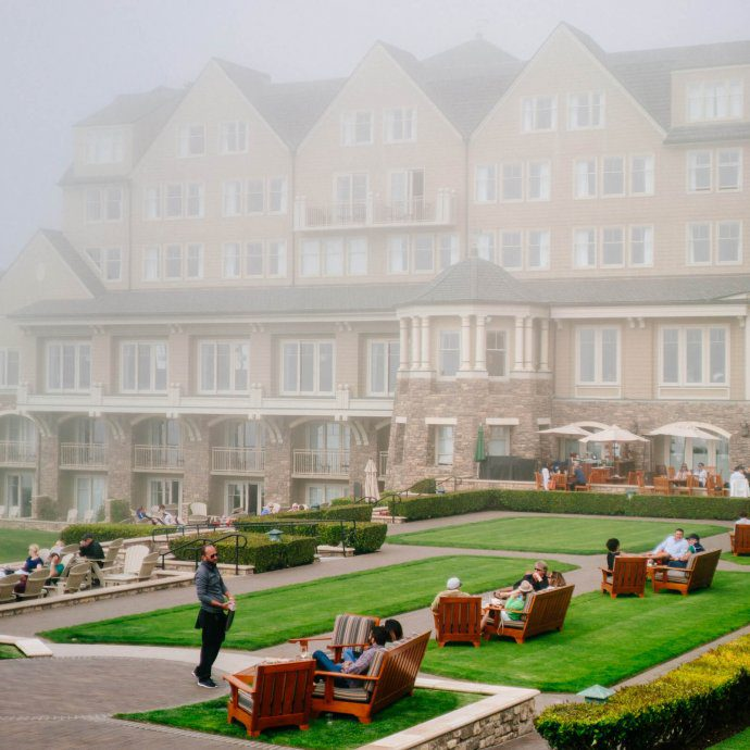 The ritz-carlton half moon bay set up on the cliffs with a beach below.
