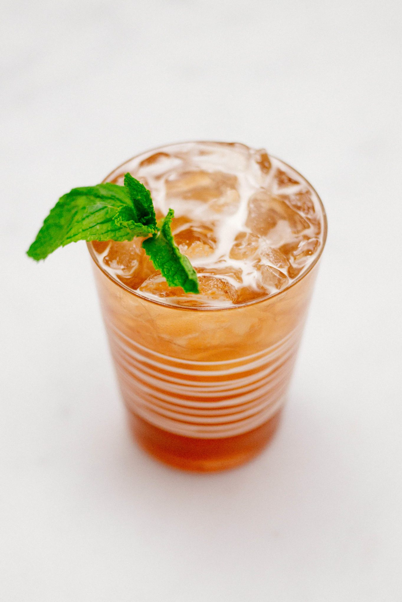 The Taste SF is garnishing a jack and ginger cocktail with pomegranate ginger ale, bourbon, and mint